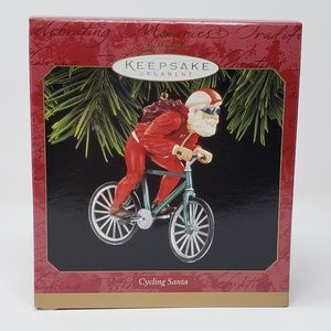 1997 Hallmark Cycling Santa Ornament.